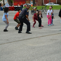 Office Kidd, 2nd District Community Engagement Officer joins in for the Cha-Cha Slide
