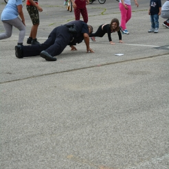 "Officer Kidd show's just how ""low"" he can go while dancing the Cha-Cha Slide"
