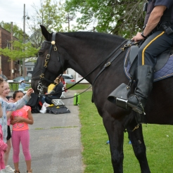 14-year-old Mandy of the Cleveland Police Mounted Unit get's attention from Julia Passafiume, age 9, and Lora Passafiume, age 5.