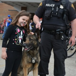Aliyah Munoz, age 5, got to spend some time with K-9 Officer Doug Nichols and six-year-old Hugo.