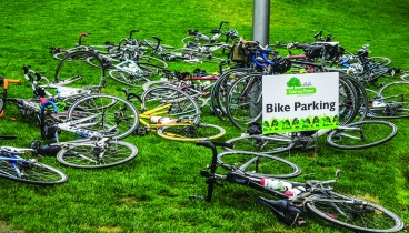 PHOTO BY MICHAEL OAKAR Wednesday, August 1, 2018; International Society of Arborists' Tour des Trees Bike Ride for Research, Cleveland Public Square: Cyclists park their bikes while listening to speakers talk about research efforts to help plant and care for urban trees.