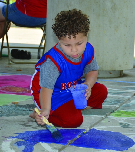 PHOTO BY CHUCK HOVEN Sunday, August 5, 2018; Puerto Rican Ceremony and Community Fair, Roberto Clemente Park, 3690 Seymour Avenue: Alex Erazo, age 5, uses his creative energy to make art.