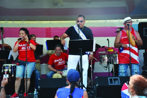 PHOTO BY CHUCK HOVEN Sunday, August 5, 2018; Puerto Rican Ceremony and Community Fair, Roberto Clemente Park, 3690 Seymour Avenue: The Salsa band, Papo Ruiz y la Dulzura de la Salsa, entertains the crowd.