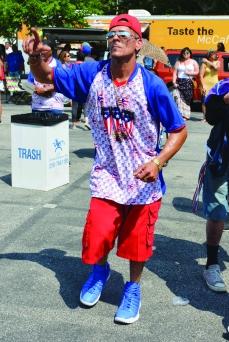 PHOTO BY CHUCK HOVEN Sunday, August 5, 2018; Puerto Rican Ceremony and Community Fair, Roberto Clemente Park, 3690 Seymour Avenue: Carlos Rios dances to the music of the salsa band, Papo Ruiz y la Dulzura de la Salsa.