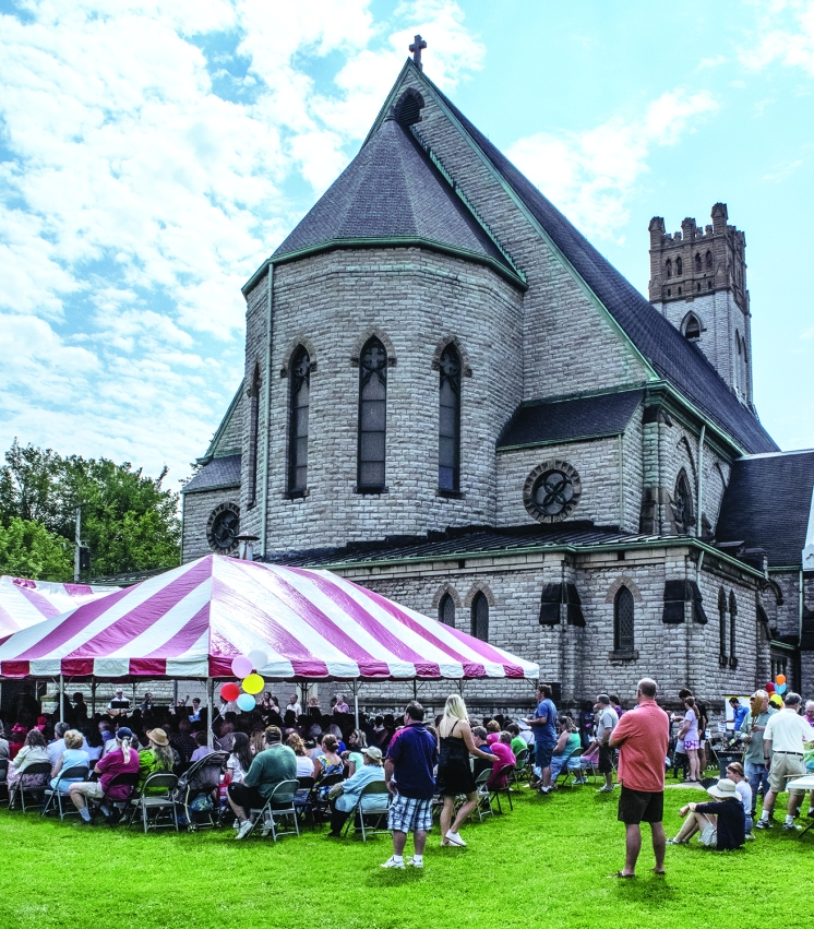 PHOTO BY MICHAEL OAKAR Sunday, August 12, 2018; Outdoor liturgy and picnic, St. Patrick's Church grounds, 3602 Bridge Avenue: Back of St. Patrick's church with parishioners attending outdoor mass. St. Patrick's 11 A.M. outdoor mass celebrated by the new pastor, Fr. Michael Gurnick.
